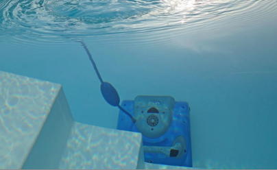 A pool vacuum floats down to the bottom of a pool that is being cleaned.